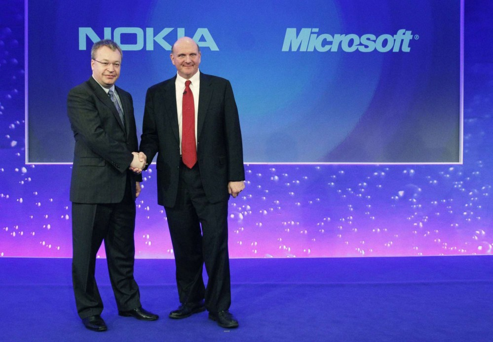File photo of Nokia chief executive Stephen Elop welcoming Microsoft chief executive Steve Ballmer with a handshake at a Nokia event in London