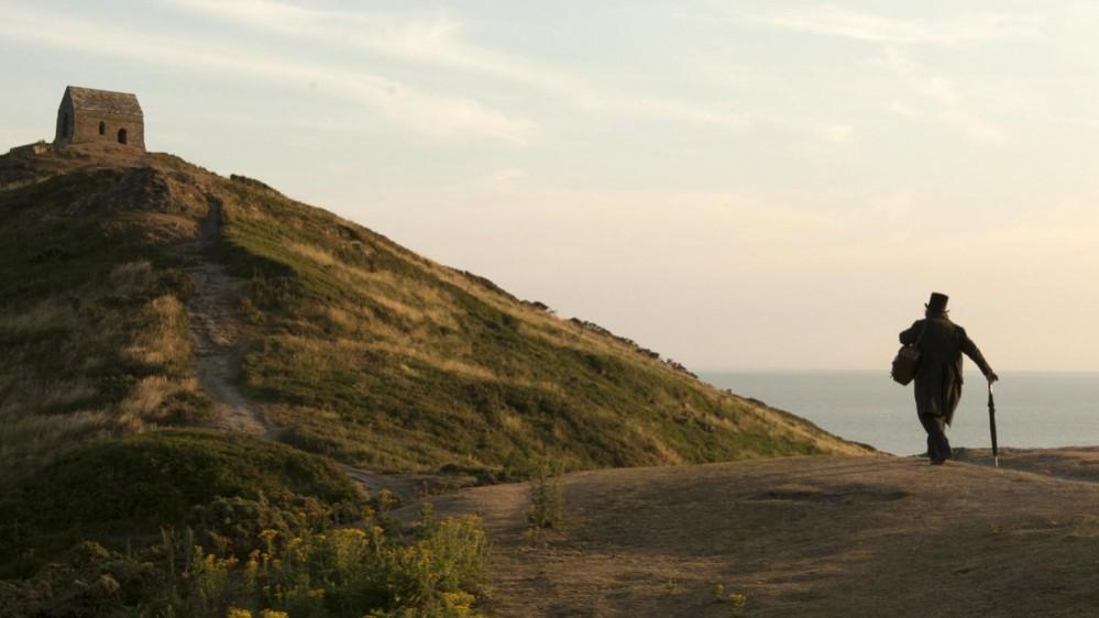 mr-turner-2014-003-turner-walking-to-hilltop-stone-cabin
