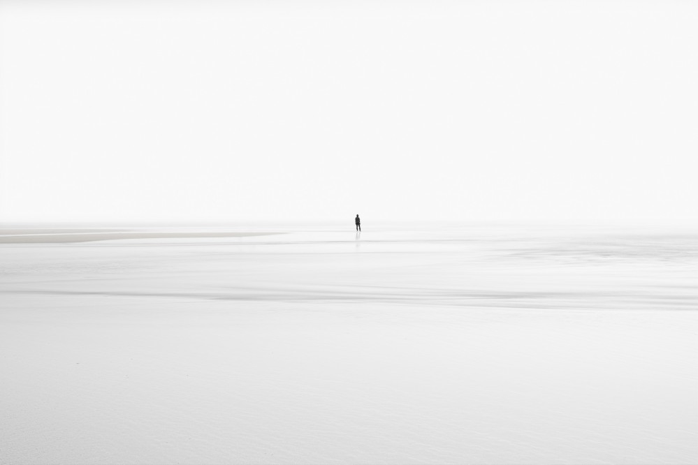 a-man-standing-on-the-beach-minimalist-photography