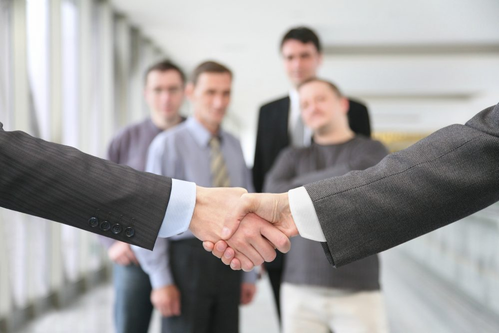 shaking hands with wrists and business team 2